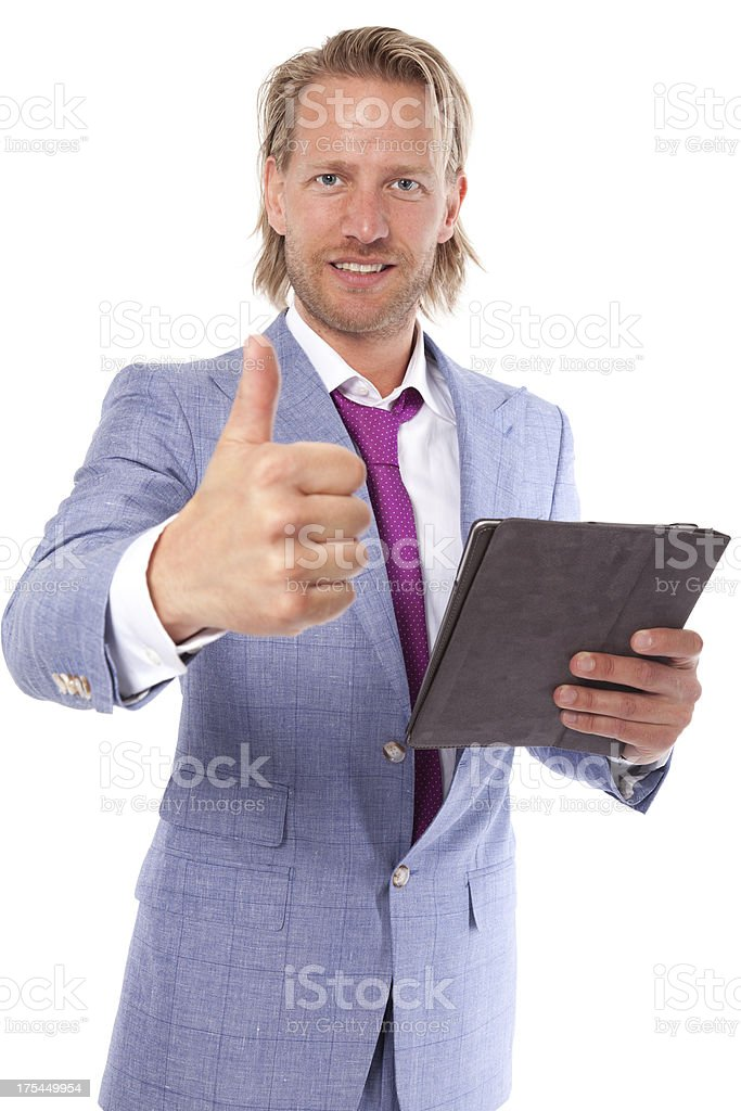 Man with tablet and thumbs-up stock photo