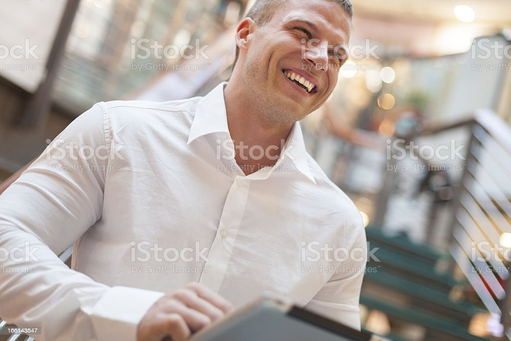 Man with tablet computer smiling stock photo