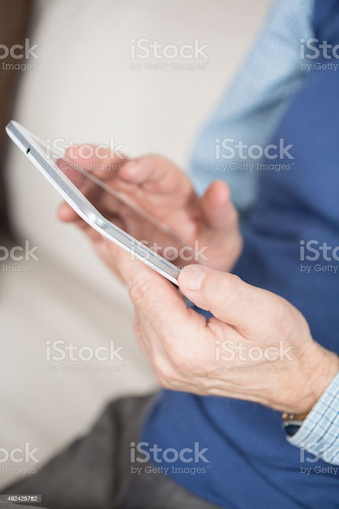Man with tablet stock photo