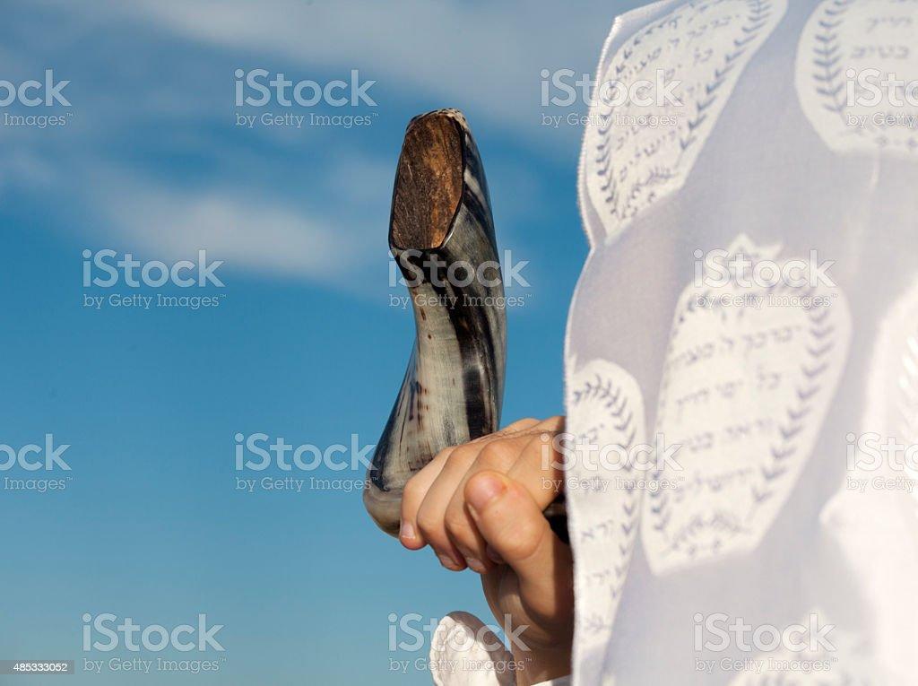man with Talit holding Shofar stock photo