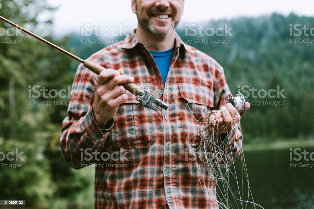 Man With Tangle Fly Fishing Tackle stock photo