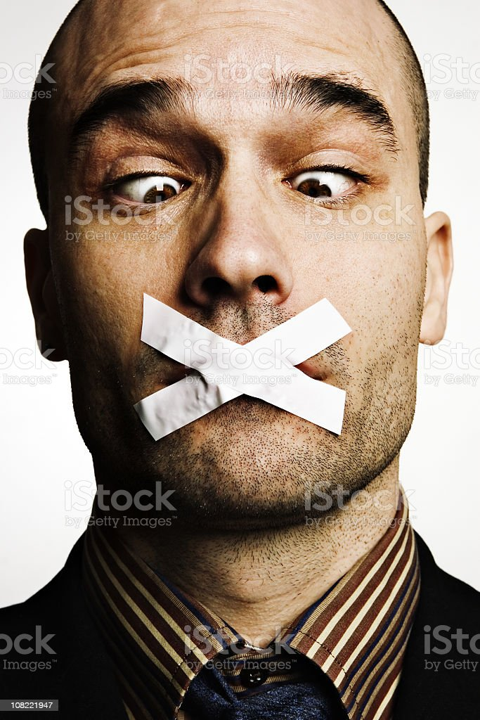 Man with tape on mouth royalty-free stock photo