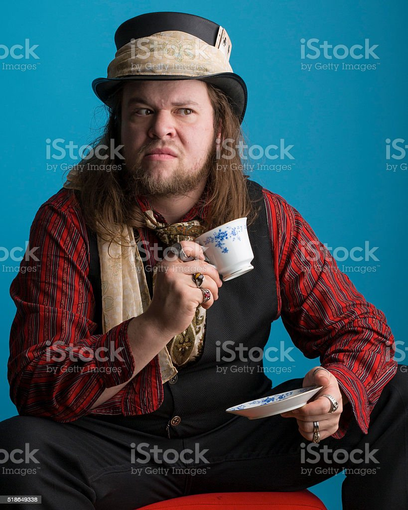 Man with tea cup sitting on footstool stock photo