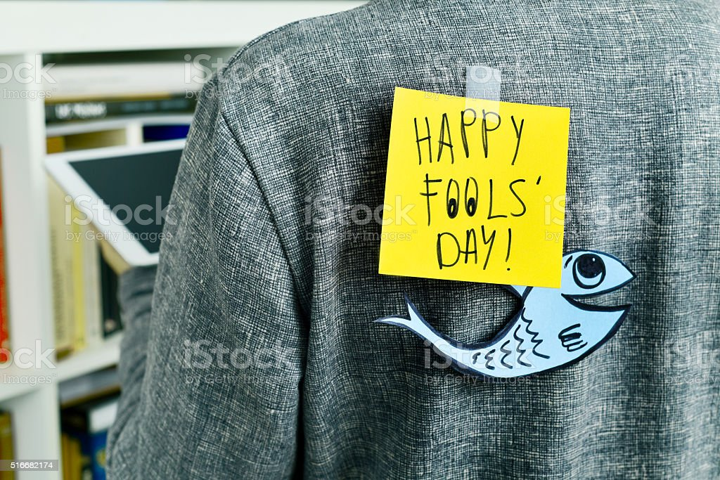 man with text happy fools day attached to his back stock photo