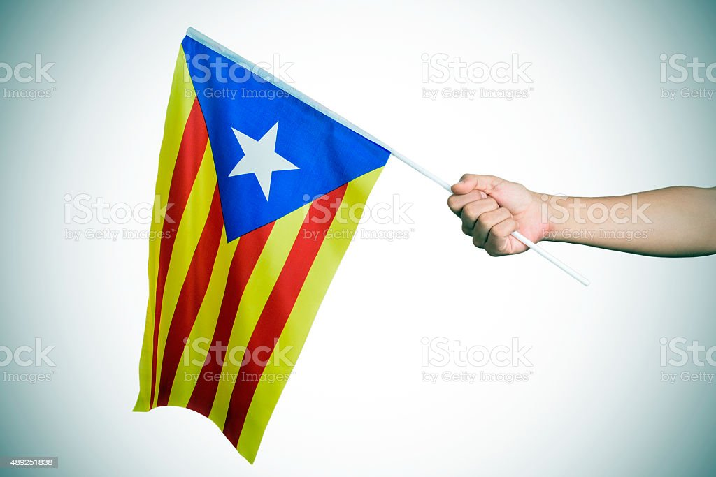 man with the Estelada, the Catalan pro-independence flag, vignet stock photo