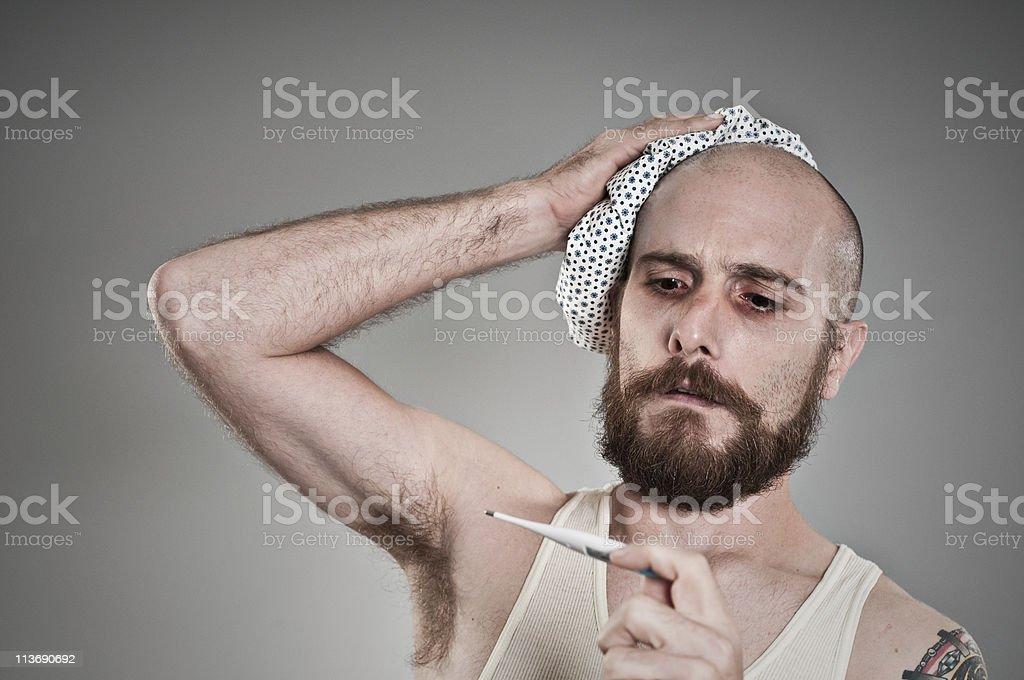 Man With The Flu Checking Thermometer royalty-free stock photo