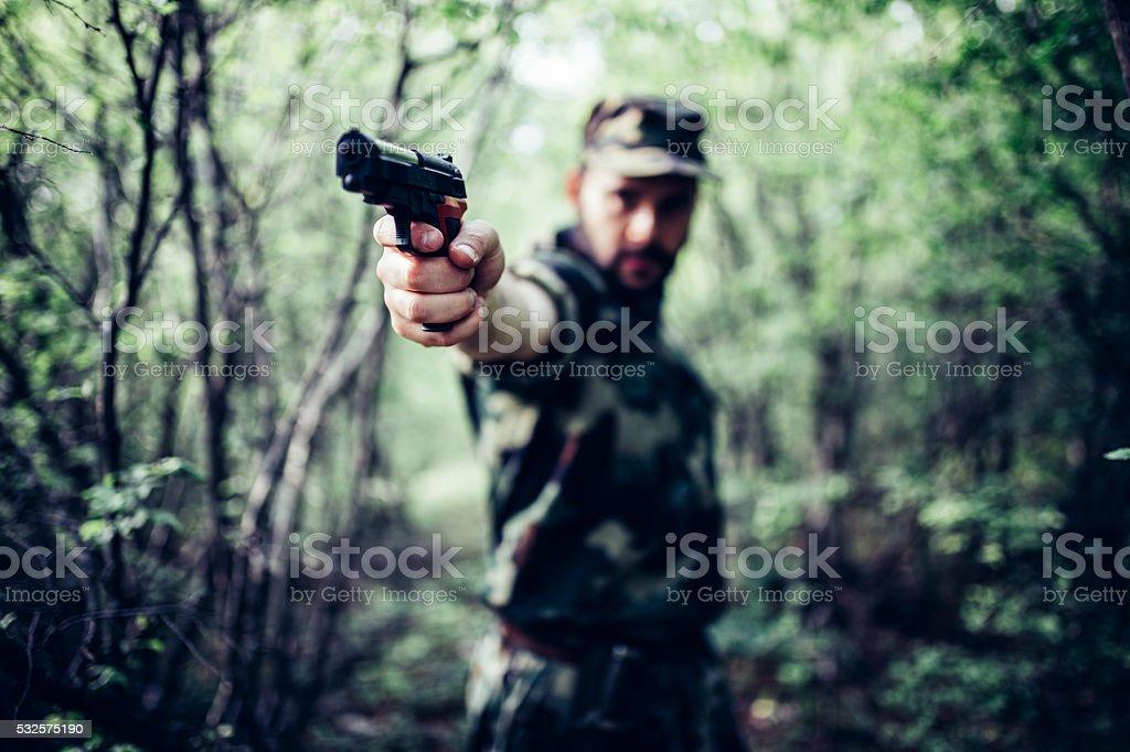 Man with the gun stock photo