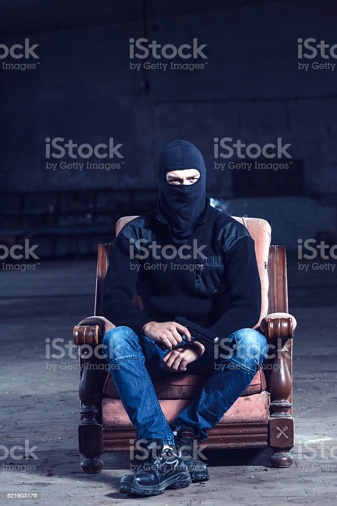 Man with the gun stock photo