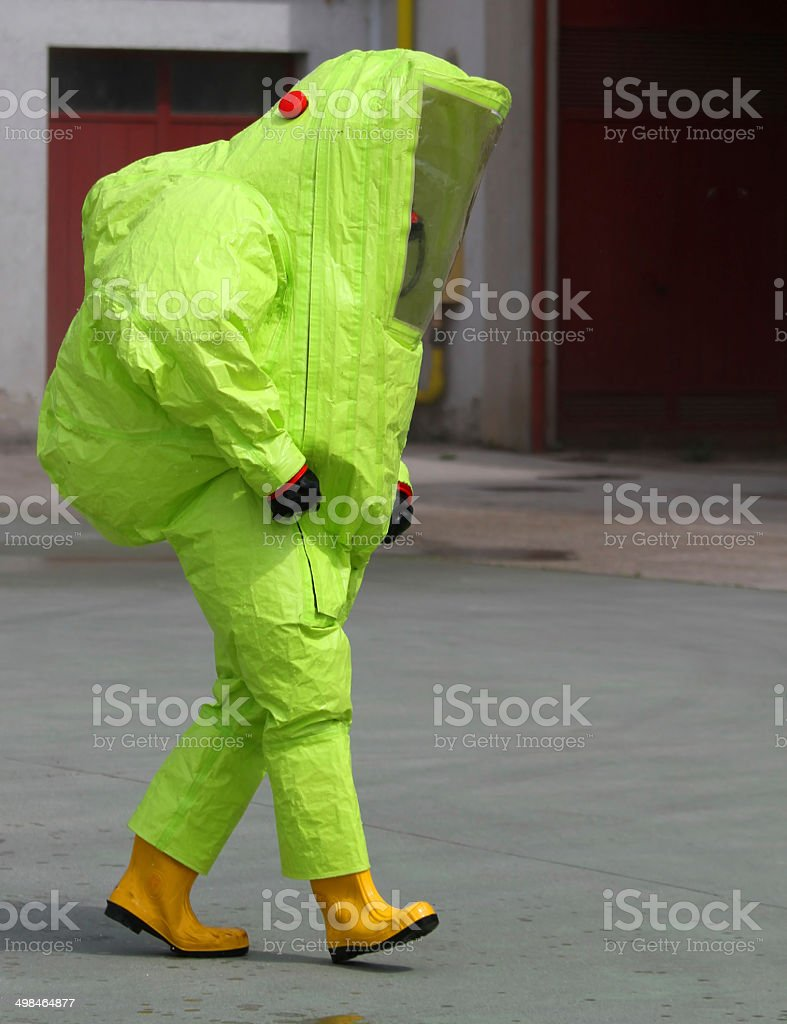 man with the suit and breathing apparatus to enter contaminated stock photo