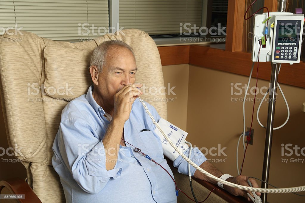 Man with Thermometer stock photo