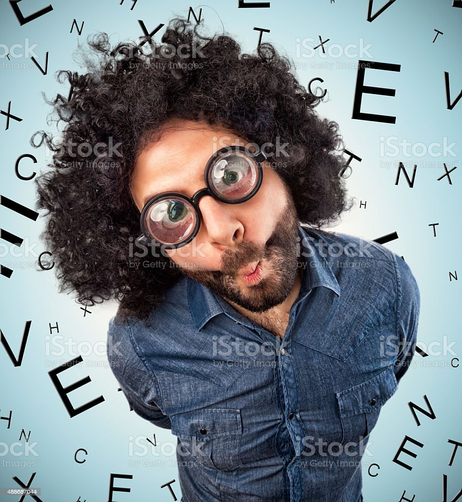 Man with thick glasses stock photo