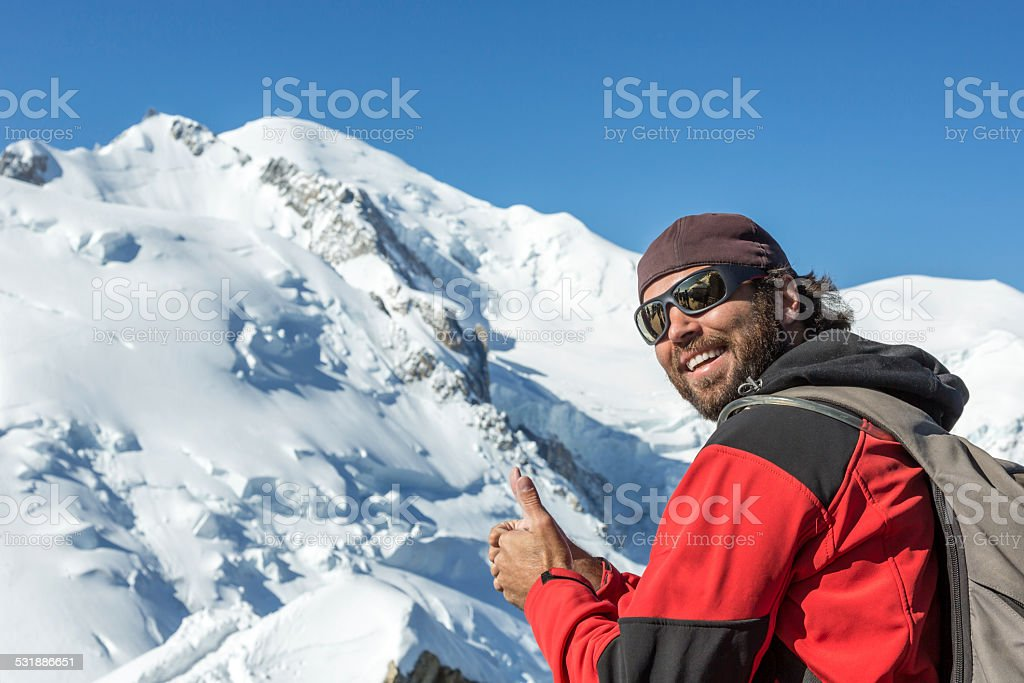 Man with thumbs up at Mont Blanc summit, France stock photo