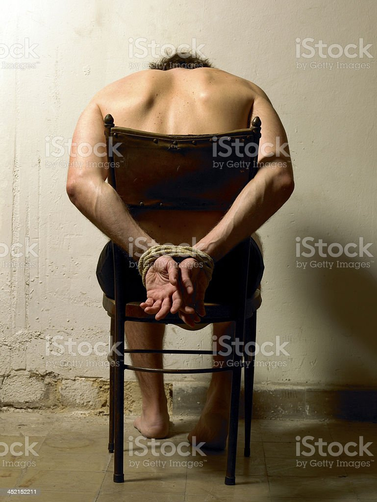 Man with tied hands stock photo
