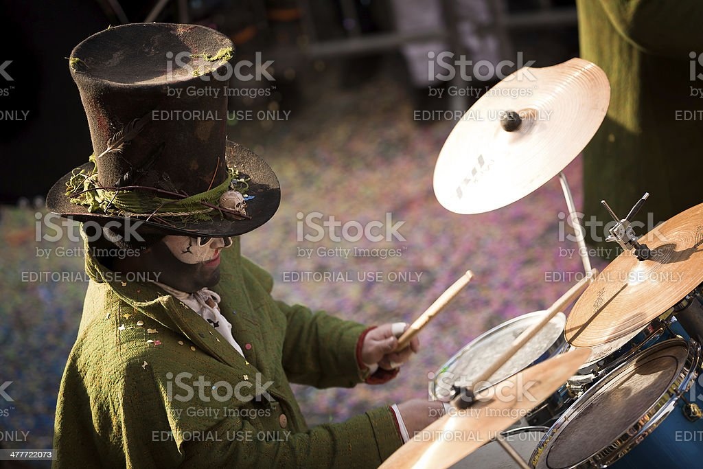 Man with top hat playing drums on Carnival parade stock photo