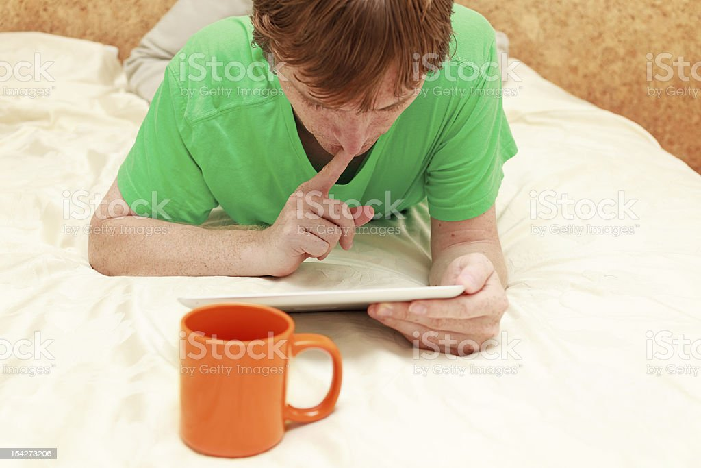 Man with touch pad at home royalty-free stock photo