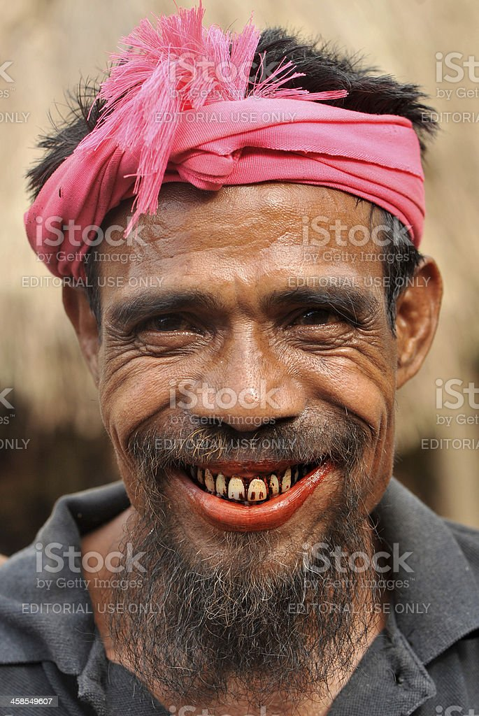Man with traditional turban at funeral ceremony in Sumba, Indonesia stock photo