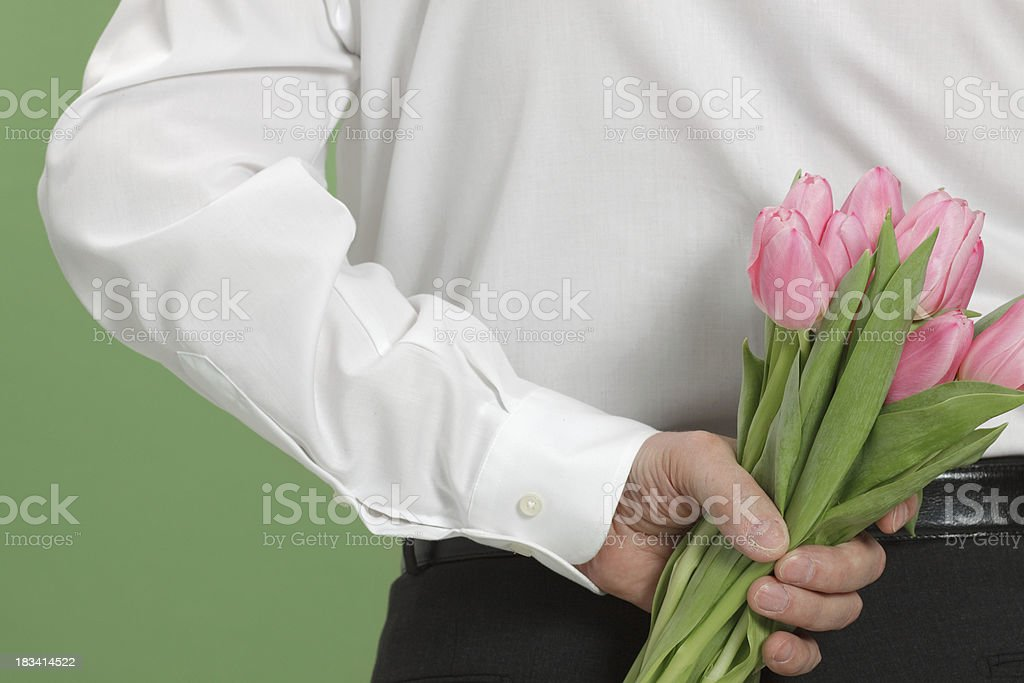 man with tulips stock photo