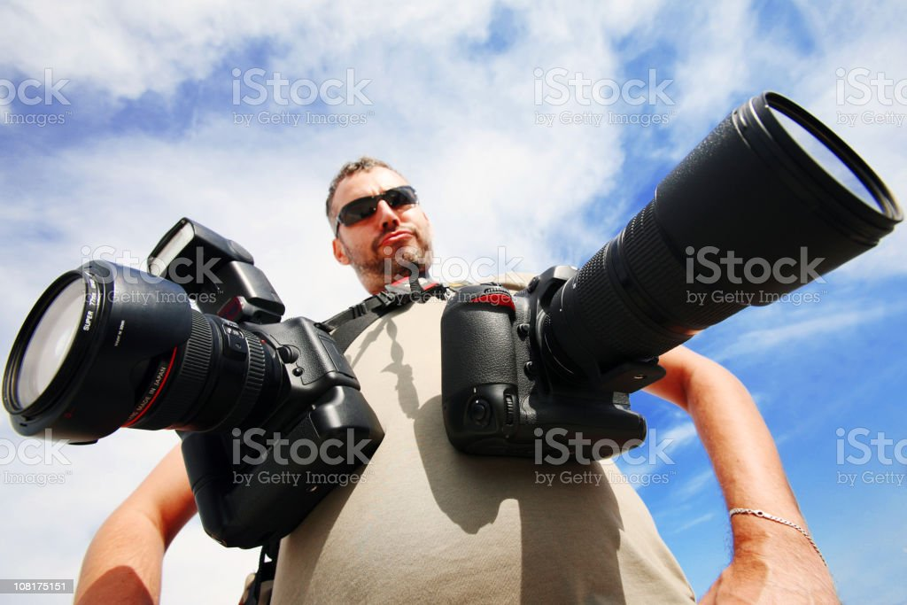 Man with Two Cameras Around Neck royalty-free stock photo