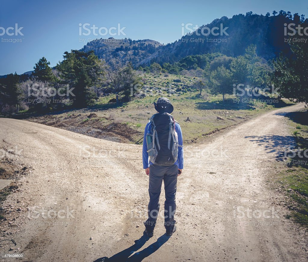 Man with two different ways stock photo