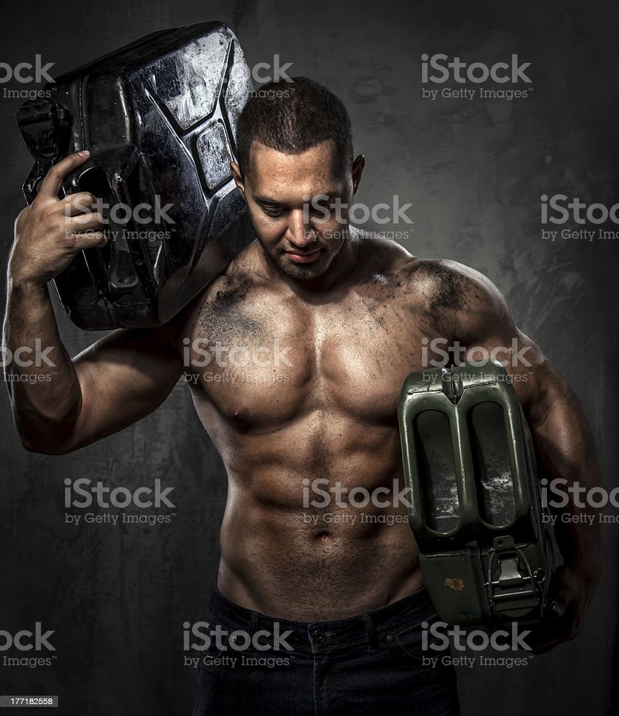 Man with two metal fuel cans royalty-free stock photo