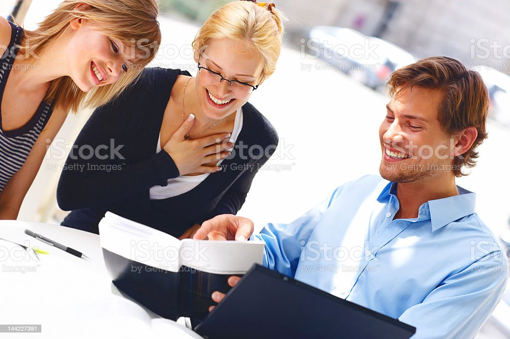 Man with two women studying royalty-free stock photo