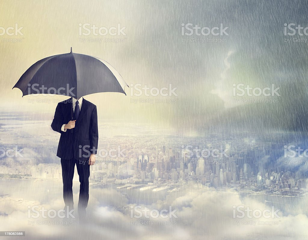 Man with Umbrella Above the City stock photo