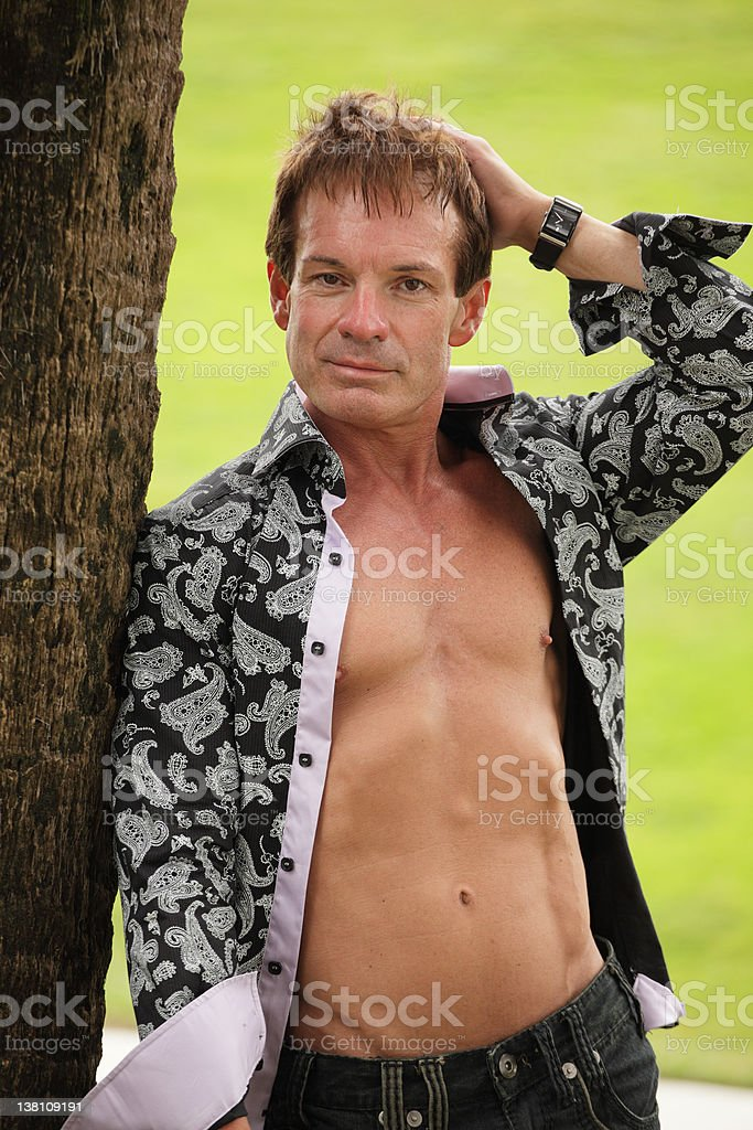 Man with unbuttoned shirt royalty-free stock photo