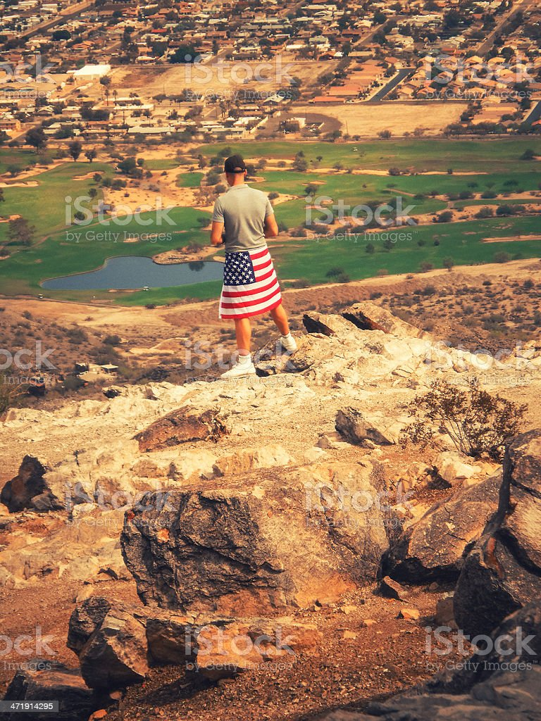 Man with us flag against phoenix panorama royalty-free stock photo