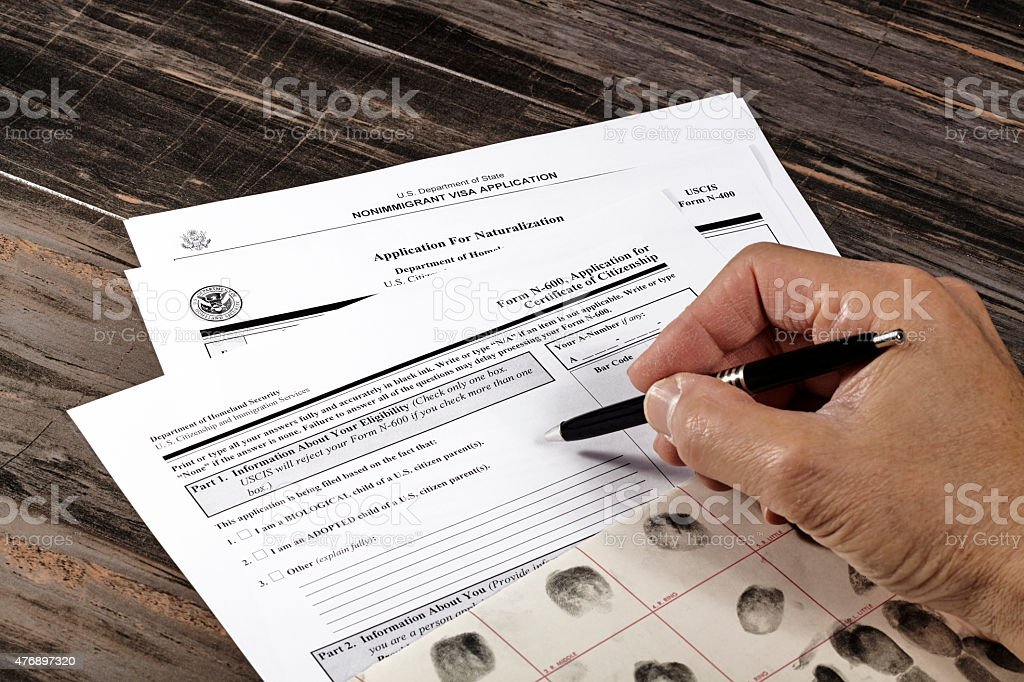 Man with USA Citizenship Application stock photo