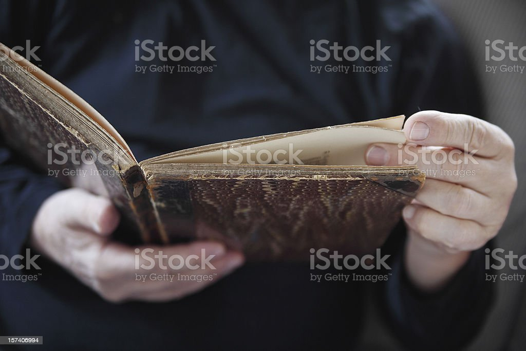 man with vintage book stock photo