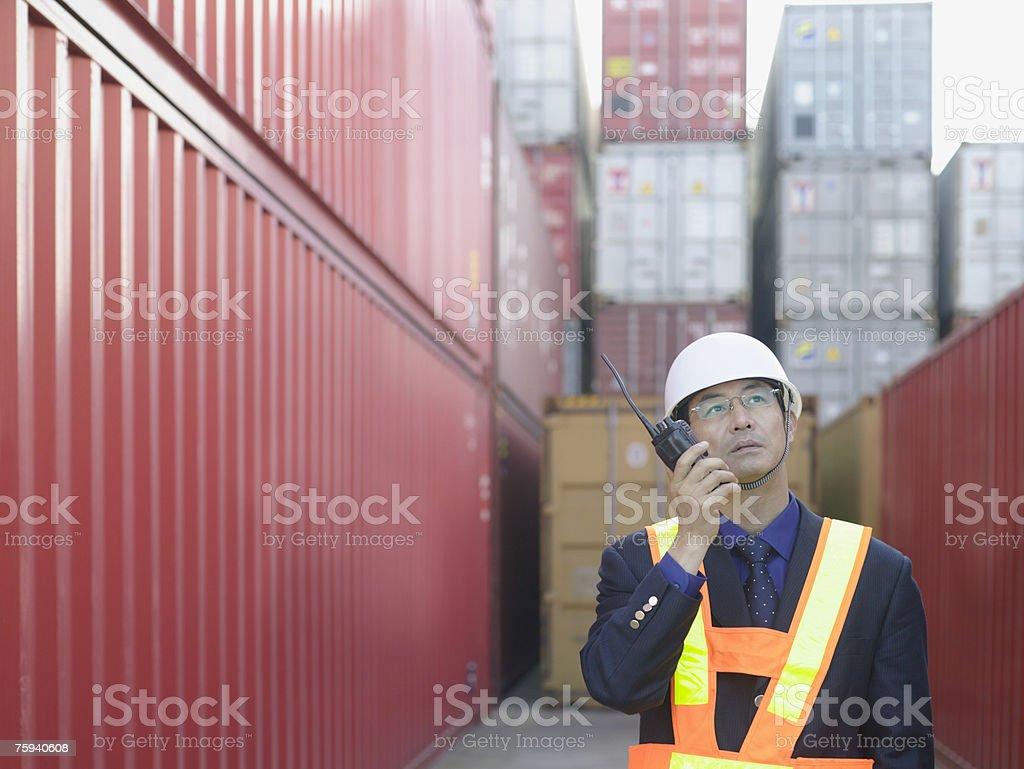 Man with walkie talkie stock photo