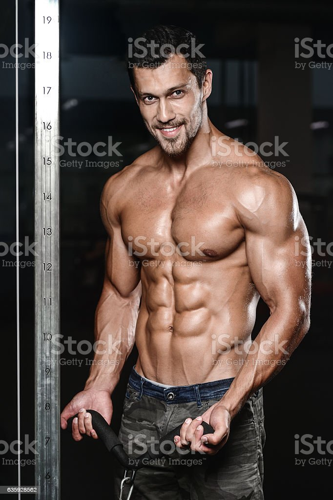 man with weight training in gym equipment sport club stock photo