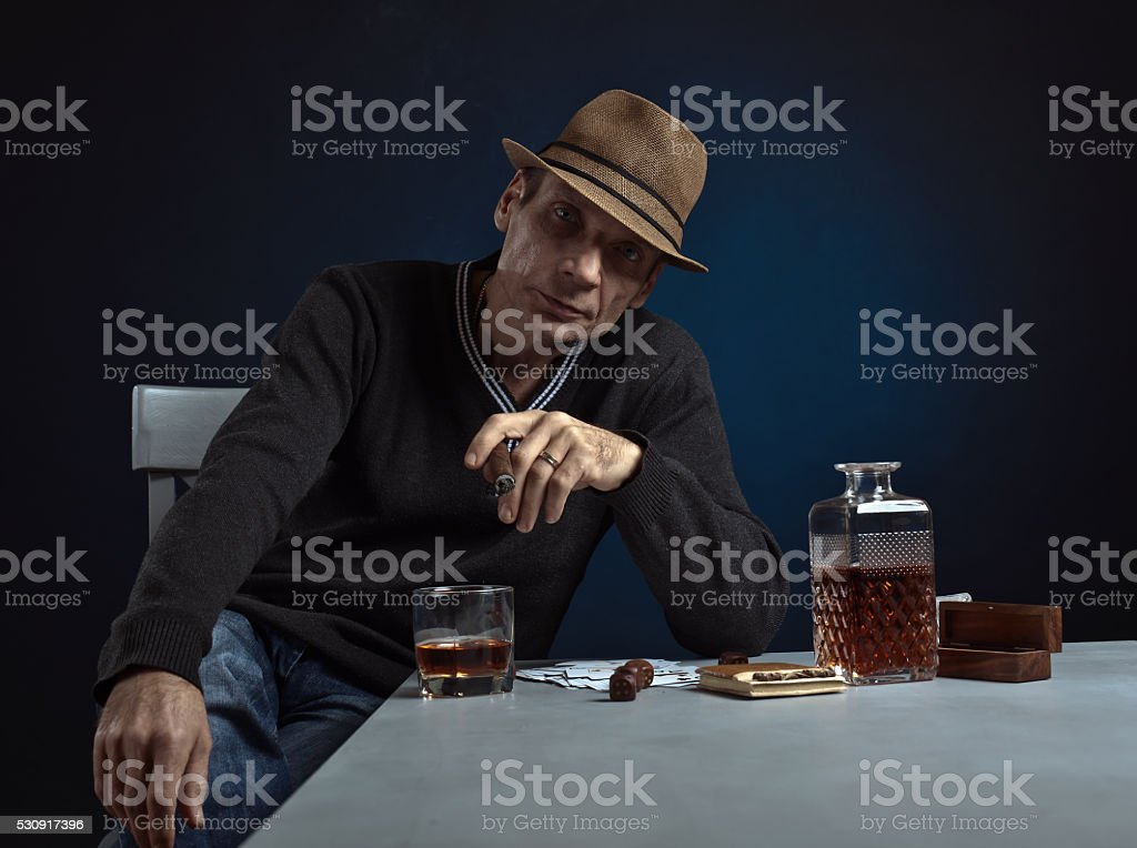 man with whiskey and cigar stock photo