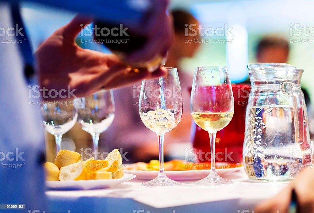 Man with white wine stock photo