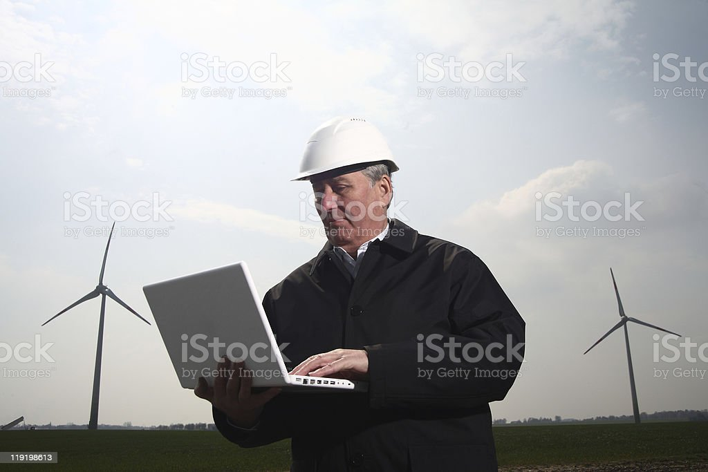 man with windturbine stock photo