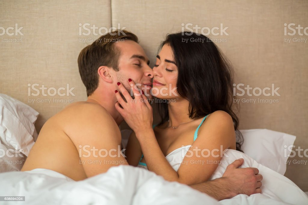 Man with woman in bed. stock photo