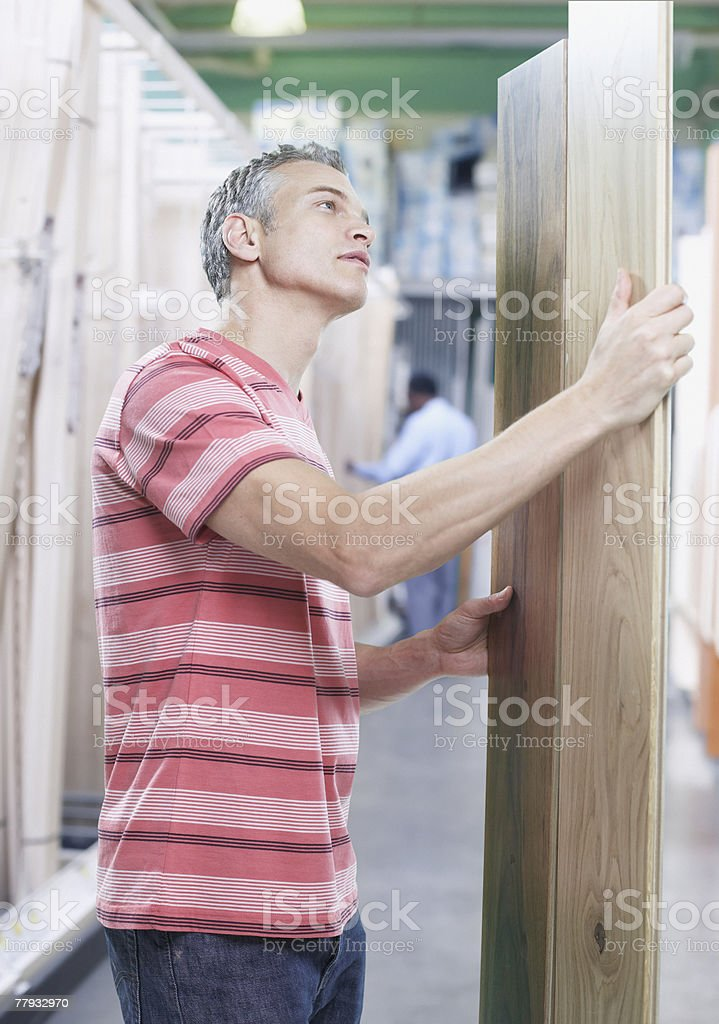 Man with wood in store royalty-free stock photo