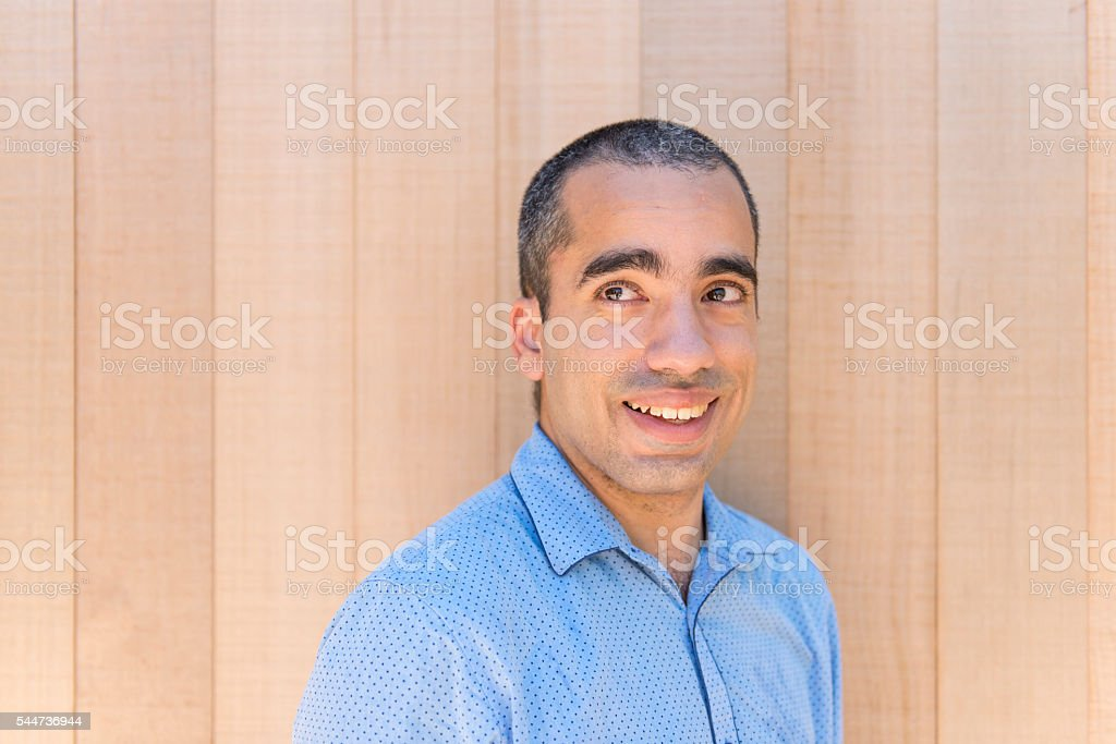 Man with wooden background stock photo