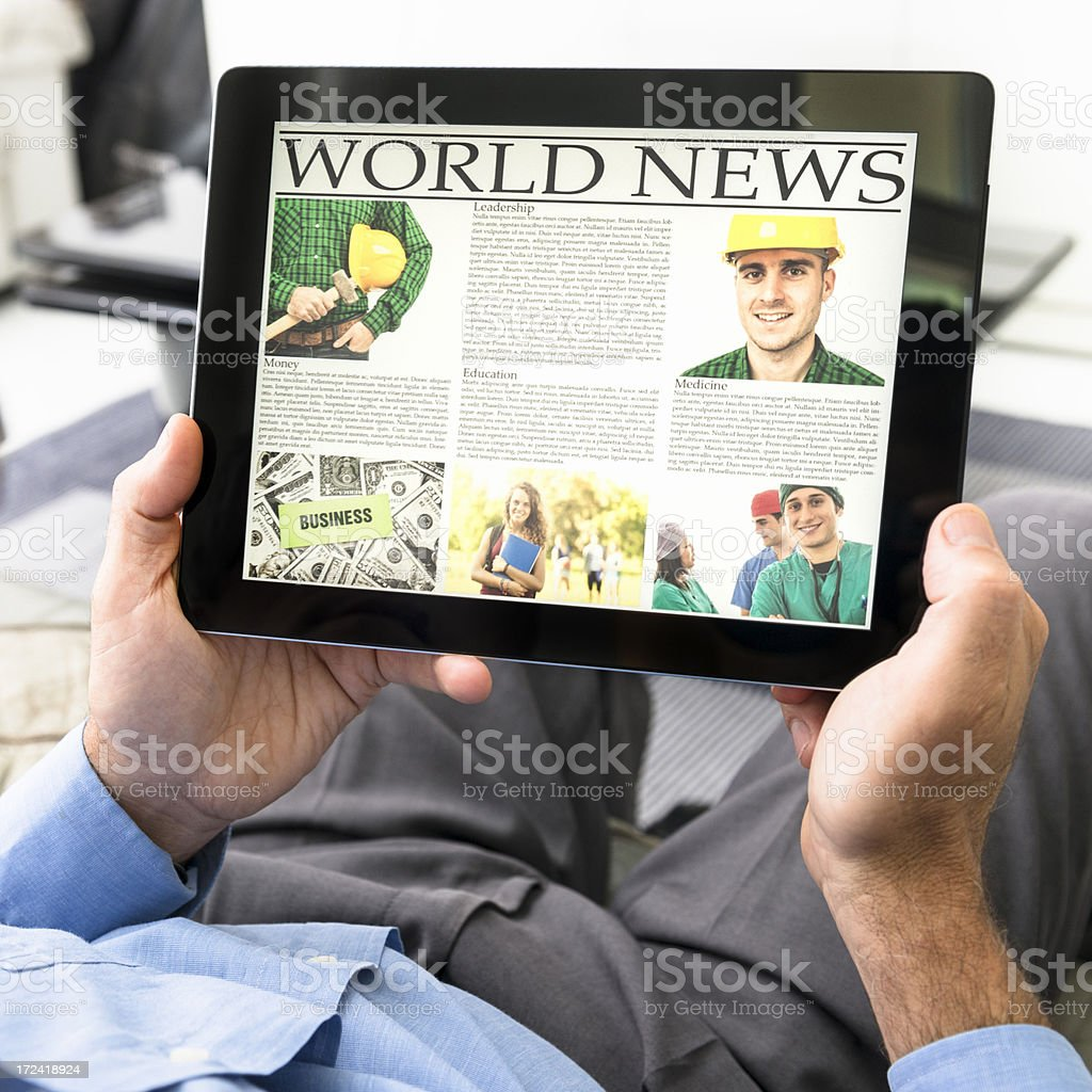 Man with World news on digital tablet - manual worker royalty-free stock photo