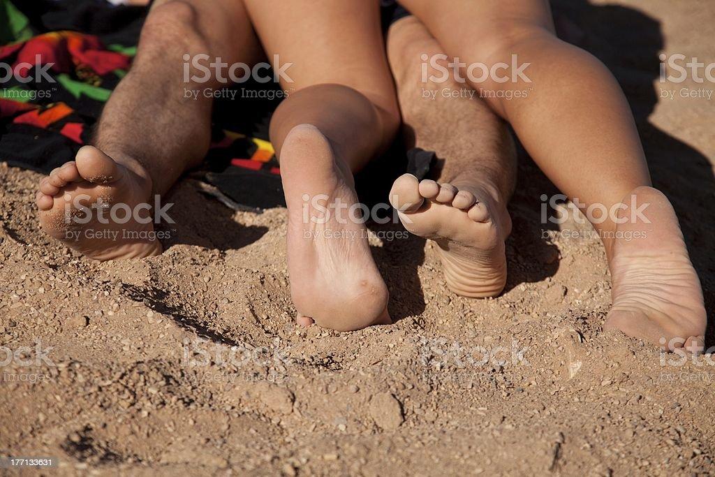 man woman feet sand royalty-free stock photo