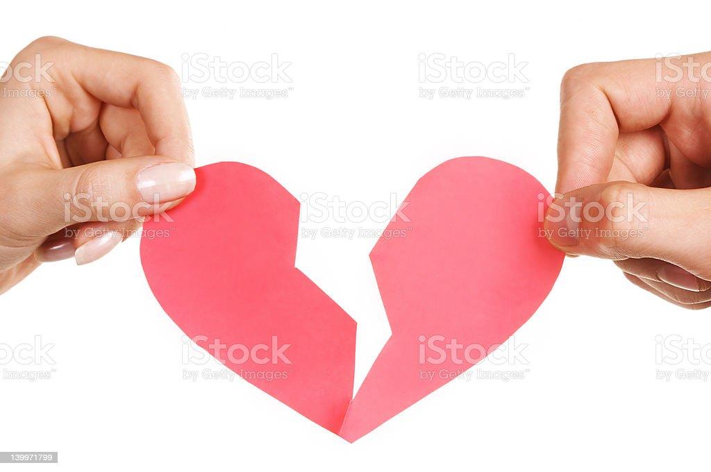 man woman hands holding broken heart stock photo