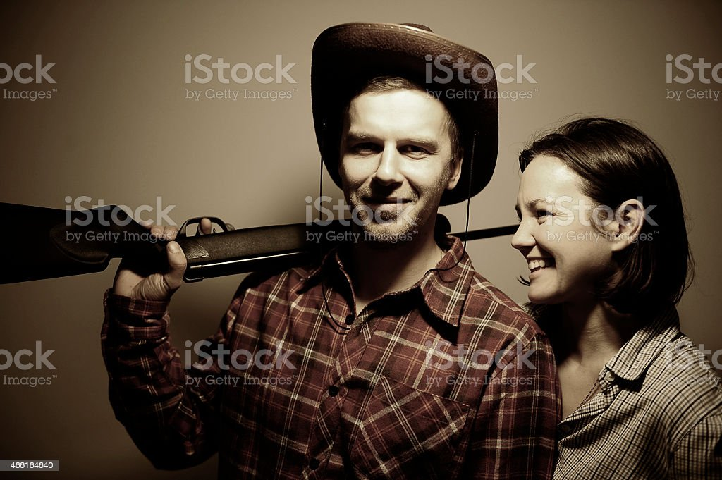 Man , woman in  style of Bonnie and Clyde. stock photo