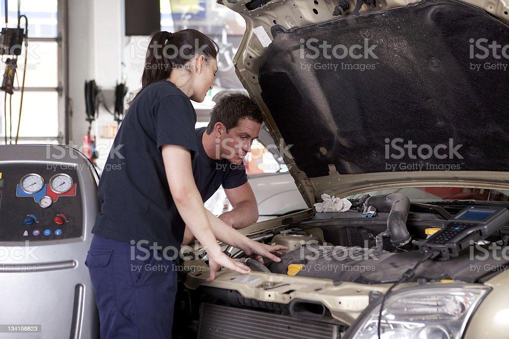 Man Woman Mechanic royalty-free stock photo