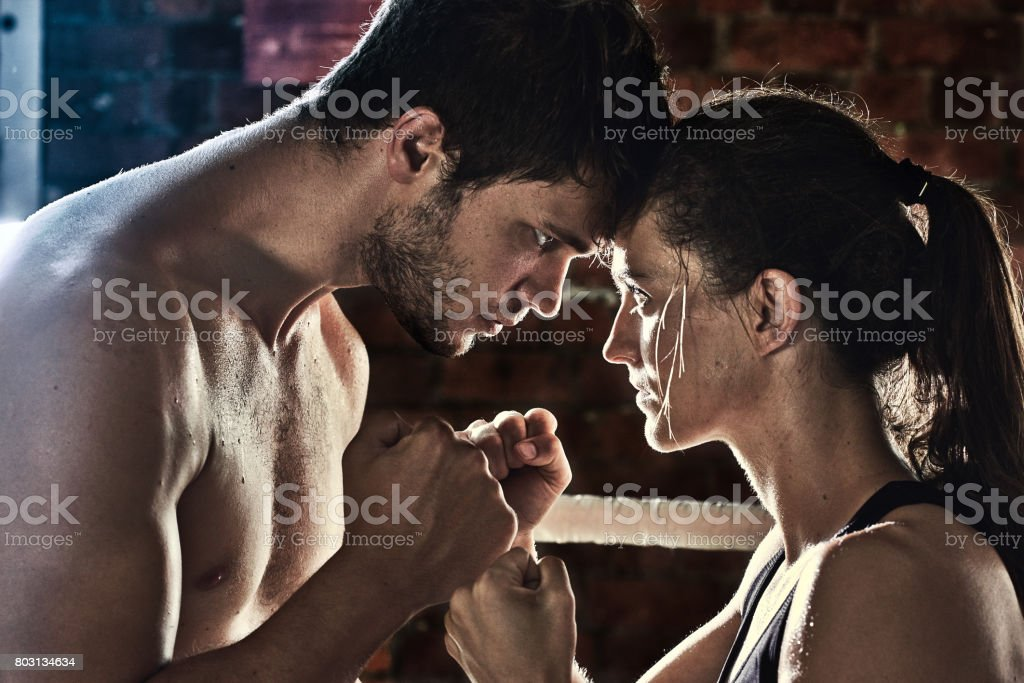 man woman training gym boxing mma ring pads mixed martial arts fitness stock photo