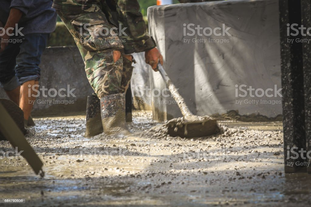Man work Floor plaster cement.Image is soft focus. stock photo