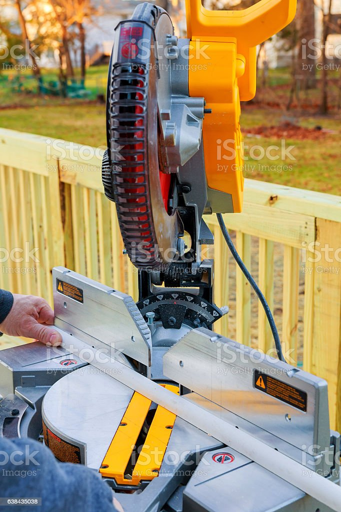 Man, worker sawing wood with a circular saw  cutting. stock photo