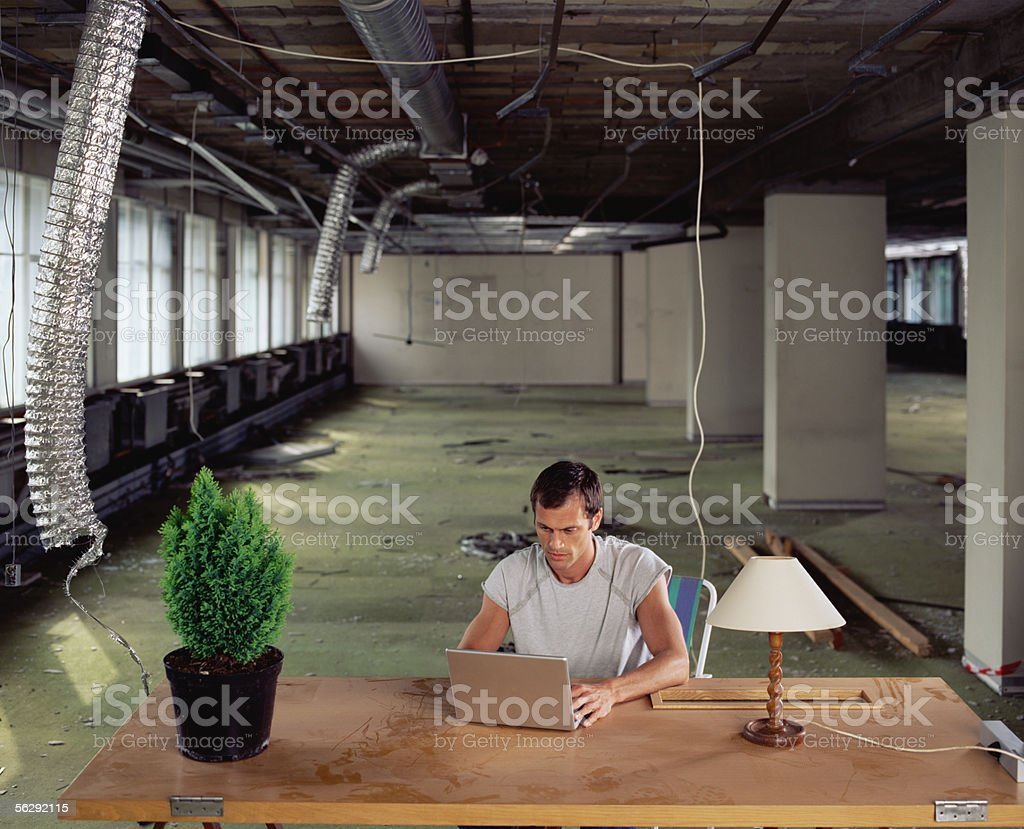 Man working alone in messy office royalty-free stock photo
