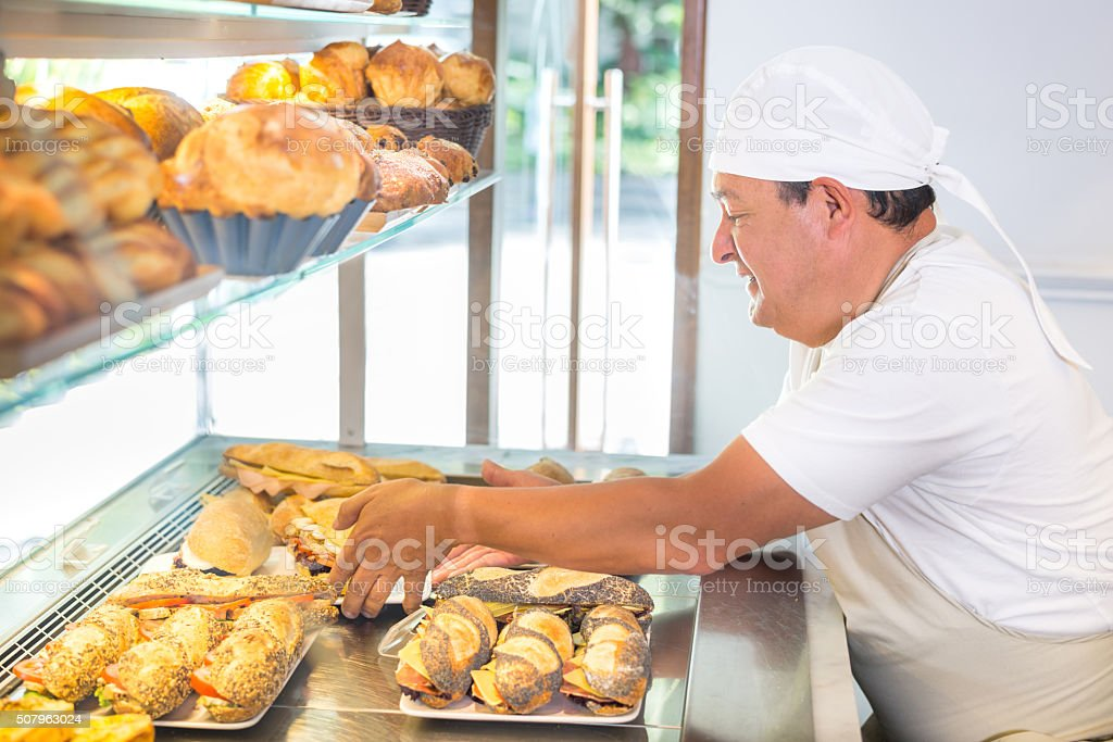 Man working at a bakery stock photo