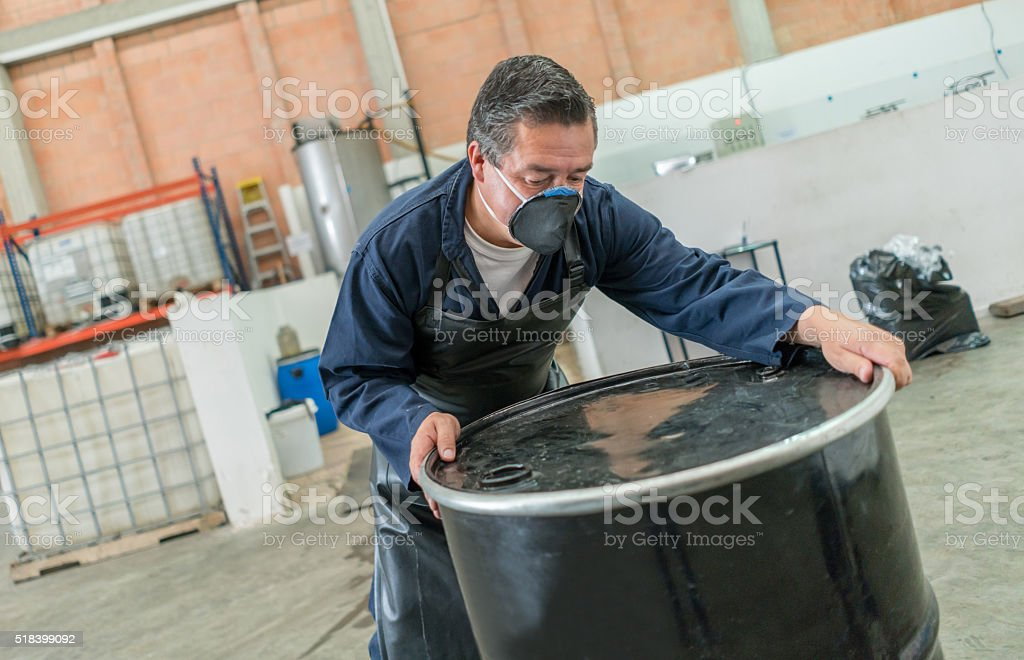Man working at a chemical factory stock photo