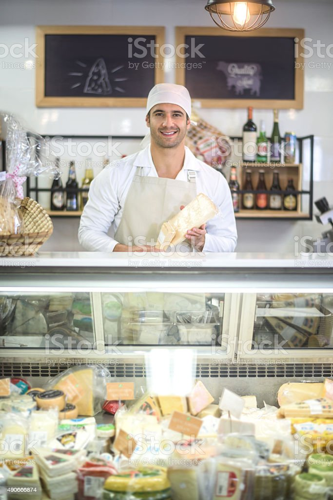 Man working at a deli stock photo